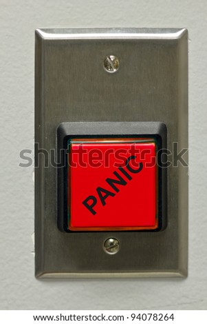 A square red panic button.
