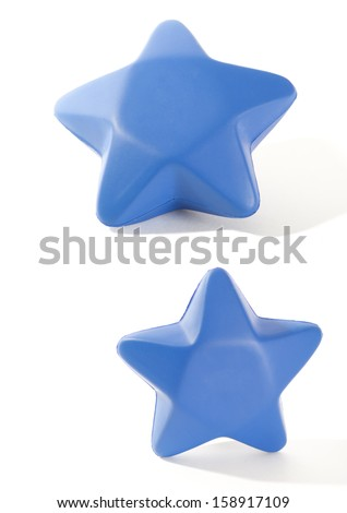 A squeezable blue foam star isolated on white. - stock photo