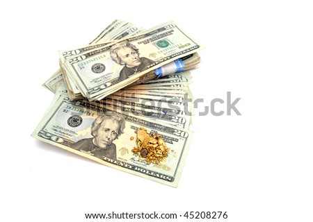 A stack of American twenty dollar bills with an ounce of raw gold nuggets on top - stock photo