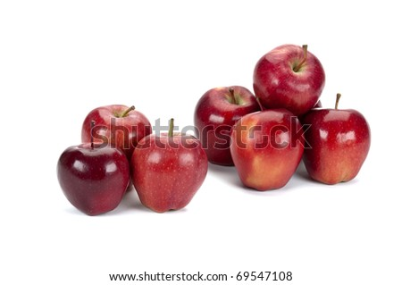 a stack of apples on a white background with space for a message or product