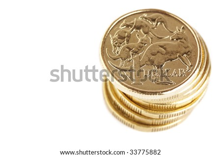 A stack of australian 1 dollar coins, isolated on a white background. - stock photo