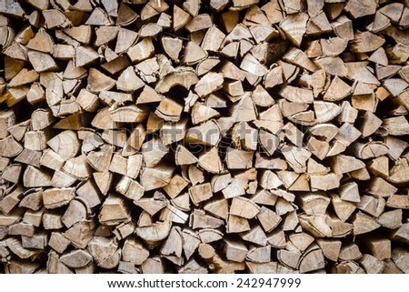 A stack of birch firewood - a natural horizontal background, close-up - stock photo