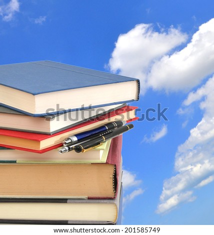 A stack of books against the sky  - stock photo