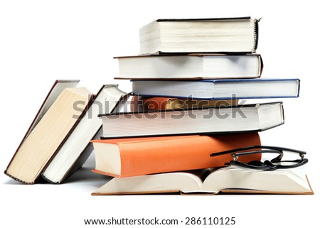 A stack of books isolated on a white background. - stock photo
