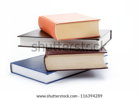 A stack of books on a white background. - stock photo
