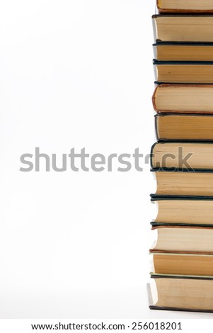 A stack of books on white background. Copy space for your text. - stock photo