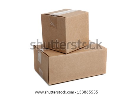 A stack of brown packing boxes on a white background - stock photo