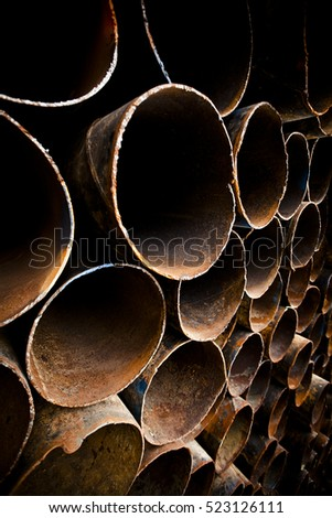 a stack of brown pipes