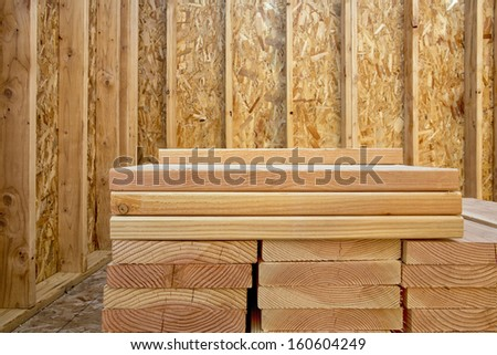 A stack of building lumber in a construction site. - stock photo