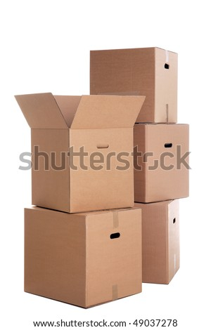 A stack of cardboard boxes isolated on a white background. - stock photo