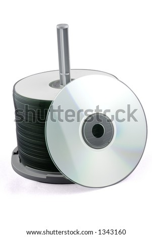 A stack of CDs on a spindle. Isolated on white with path. - stock photo