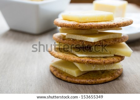 A stack of cheese and crackers piled high.