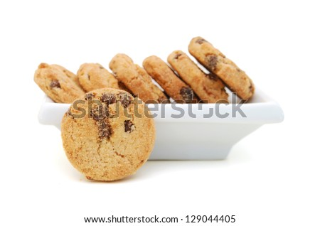 A stack of chocolate chip cookies in plate on a white background. - stock photo