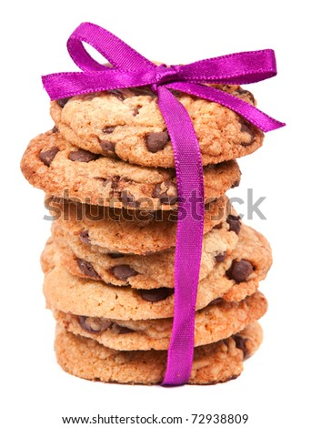 A stack of chocolate cookies tied with pink ribbon isolated on white background - stock photo