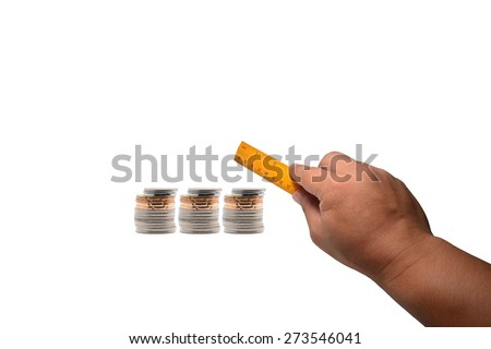 A stack of coin and hand holding ruler isolated on white background - stock photo