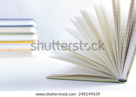 A stack of colorful books and open book. Ideas for business and self-development - stock photo