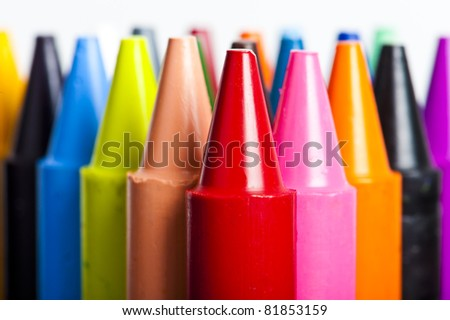 A stack of colorful crayons on an isolated white background. - stock photo