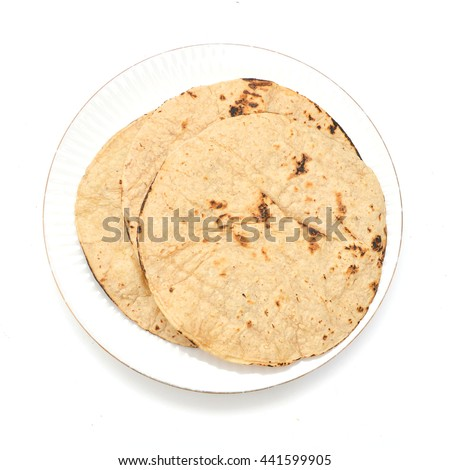 A stack of corn tortillas in plate on a white background