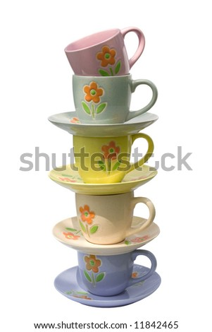 A stack of cups and saucers isolated on white