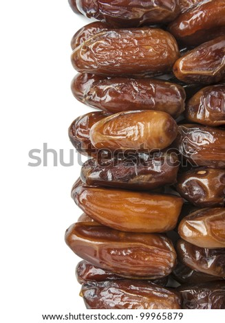 A stack of delicious date fruits on a white background