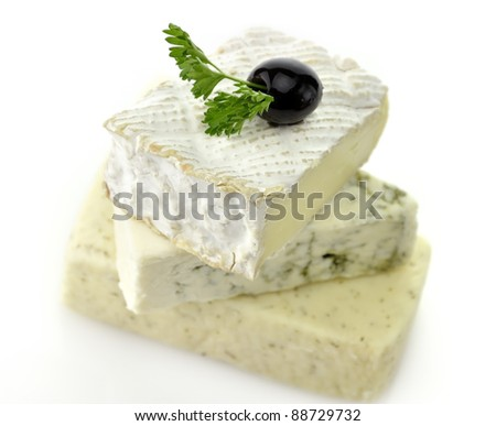 A Stack Of Different Kinds Of Cheese On White Background - stock photo