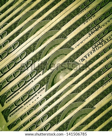 a stack of 100 dollar bills