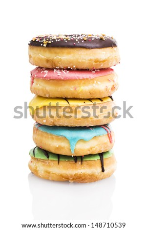 A stack of donuts on white background  - stock photo