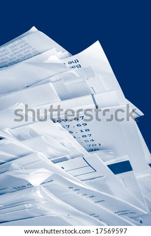 a stack of due  monthly bill payments in blue tones - stock photo