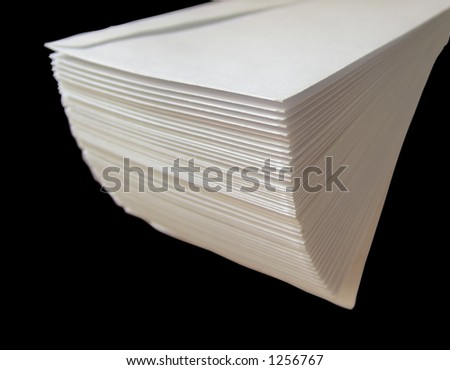 A stack of envelopes isolated on black