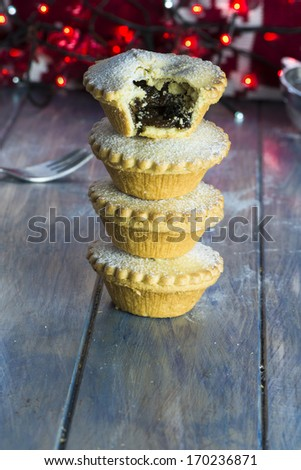 A stack of festive Christmas mince pies - stock photo