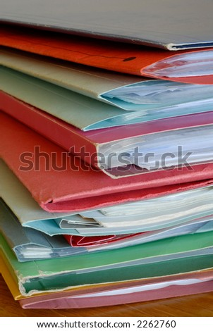 A stack of folders & papers.