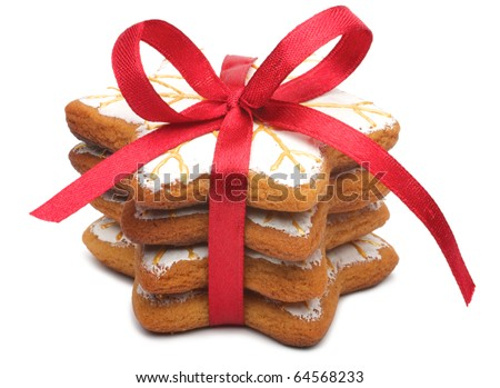 A stack of four cookies. Cookies tied a red ribbon. This fine handcrafted and painted by hand. Cookies in the shape of the snowflake. Isolated on white background.