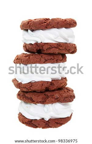 A stack of fresh, soft, chewy, cream filled chocolate sandwich cookies, known as Oreo Wannabes. - stock photo