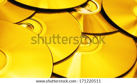 A stack of golden tinted discs - stock photo