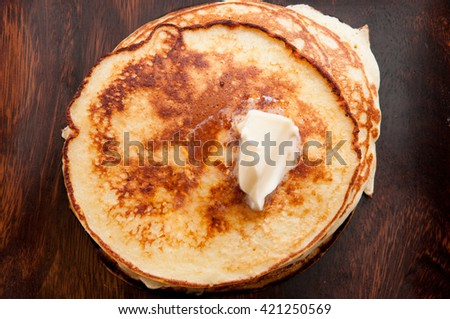 a stack of hamemade pancakes with butter - stock photo