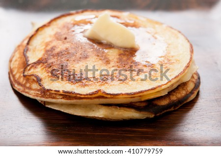 a stack of homemade pancakes with butter - stock photo