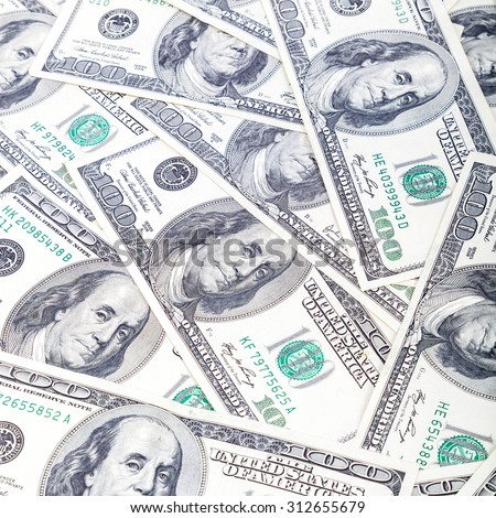 A stack of hundred-dollar bills as a background. - stock photo