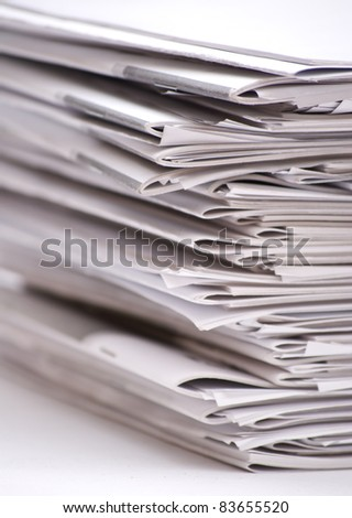 a stack of magazines - stock photo
