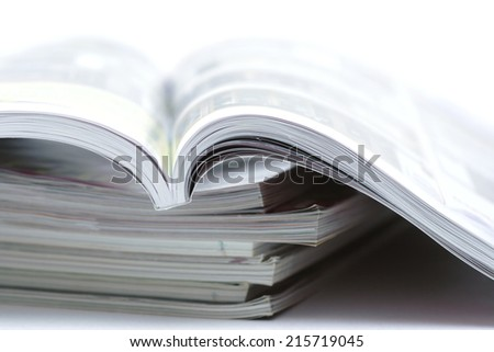 a stack of magazines closeup.