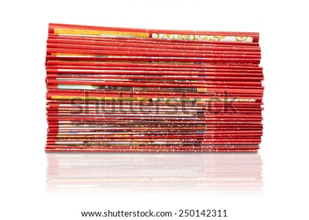 A stack of magazines in red isolated on white background. - stock photo