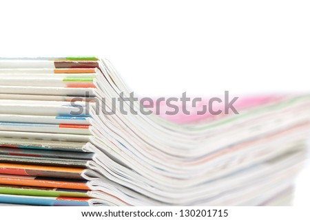 A stack of magazines on a white background. Close-up. - stock photo