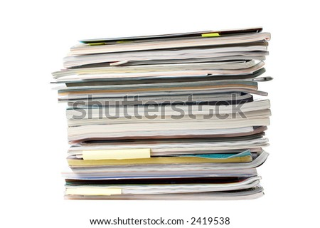 A stack of magazines over a white background