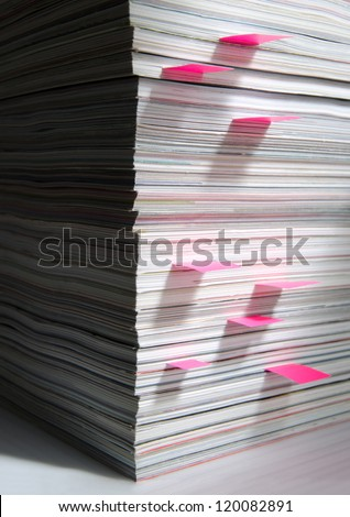 A stack of magazines with place holders