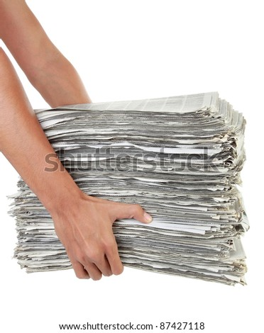 a stack of newspaper in hand isolated on white background - stock photo