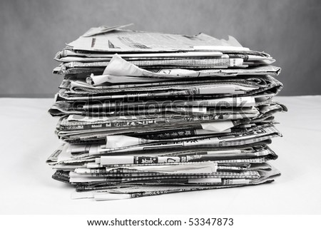 A stack of newspapers - stock photo