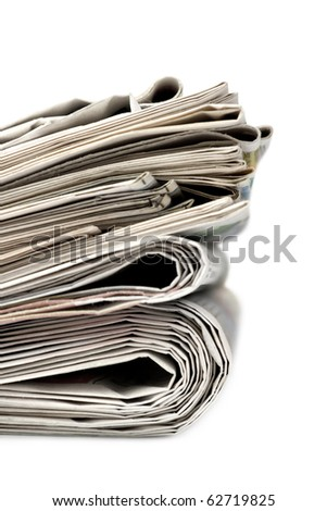 A stack of newspapers. Isolated on white background. - stock photo