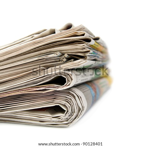 A stack of newspapers. Isolated on white background.