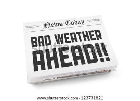 "A stack of newspapers with headline sign ""Bad Weather Ahead"". Isolated on white. - stock photo"