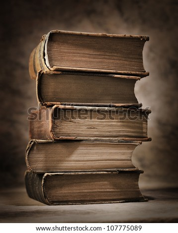 A Stack of old antique books. - stock photo