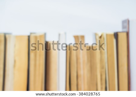 A stack of old books in hard and soft cover blurred background. Blur books of Background - stock photo